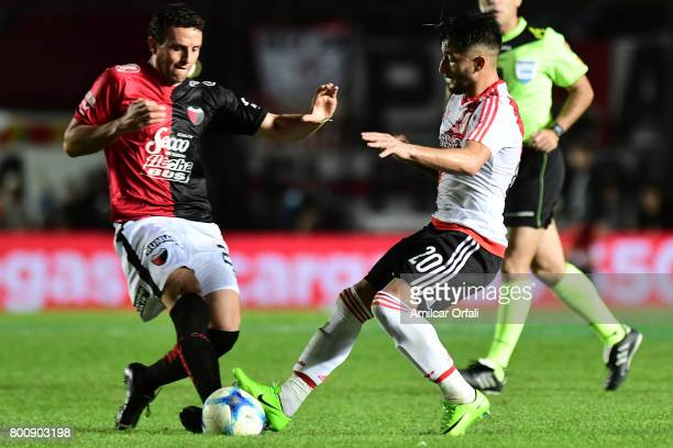 Pablo Ledesma of Colon fights for the ball with Milton Casco of River Plate during a match between Colon and River Plate as part of Torneo Primera...
