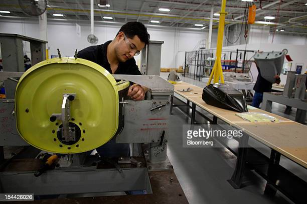 Pablo Leon builds a landing gear pod for an A10 Thunderbolt II war plane at the CPI Aerostructures Inc manufacturing facility in Edgewood New York US...