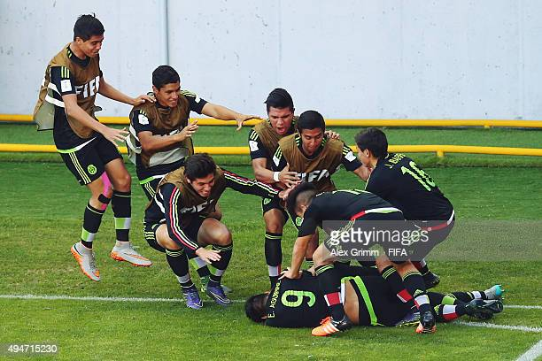 Pablo Lopez of Mexico celebrates his team's second goal with team mates during the FIFA U17 World Cup Chile 2015 Round of 16 match between Mexico and...