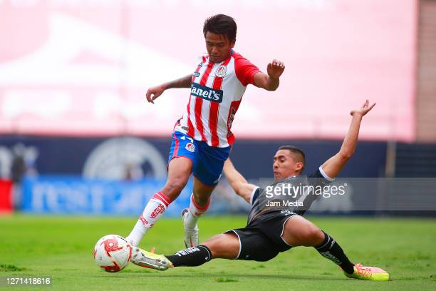 Pablo Lopez of San Luis fights for the ball with Ricardo Chavez of Necaxa during the 9th round match between Atletico San Luis and Necaxa as part of...