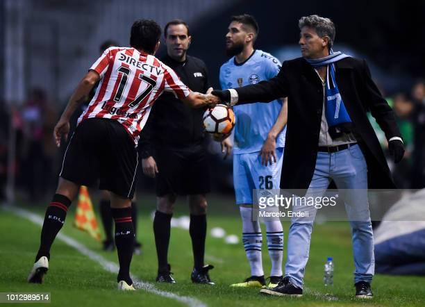 Pablo Luguercio of Estudiantes La Plata greets Renato Gaucho coach of Gremio during a round of sixteen first leg match between Estudiantes de La...