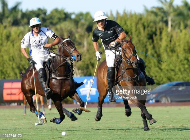 Pablo Mac Donough of Richard Mille and Adolfo Cambiaso of Valiente chase a loose ball during The Palm Beach Open on March 15 2020 at the Grand...