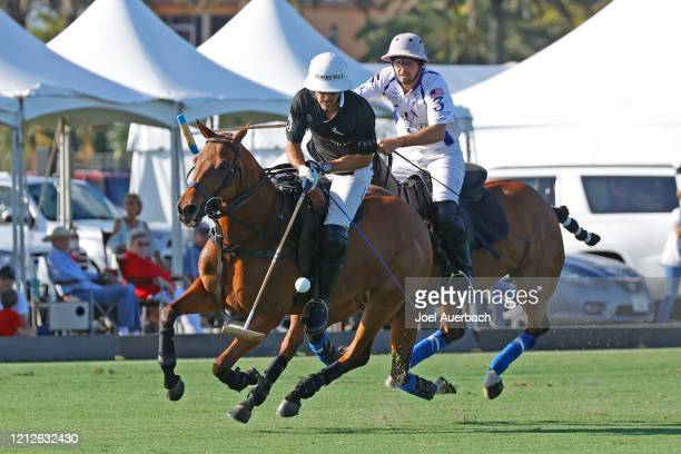 Pablo Mac Donough of Richard Mille plays the ball in front of Diego Cavanagh of Valiente during The Palm Beach Open on March 15 2020 at the Grand...