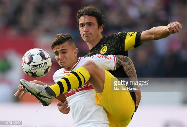 Pablo Maffeo Becerra of VfB Stuttgastock challenges for the ball with Thomas Delaney of Borussia Dortmund during the Bundesliga match between VfB...