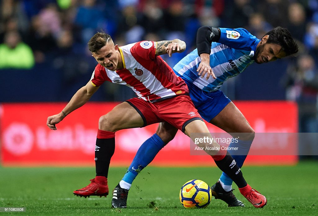 Pablo Maffeo of Girona FC (L) competes for the ball with Jose Luis Garcia 'Recio' of Malaga CF (R) during the La Liga match between Malaga and Girona at Estadio La Rosaleda on January 27, 2018 in Malaga, Spain.
