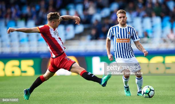 Pablo Maffeo of Girona FC duels for the ball with Kevin Rodrigues of Real Sociedad during the La Liga match between Real Sociedad de Futbol and...