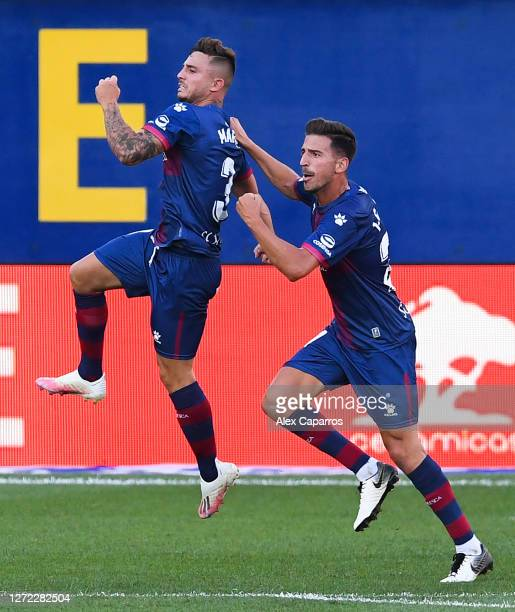 Pablo Maffeo of SD Huesca celebrates with his team mate Juan Carlos of SD Huesca after scoring his team's first goal during the La Liga match between...