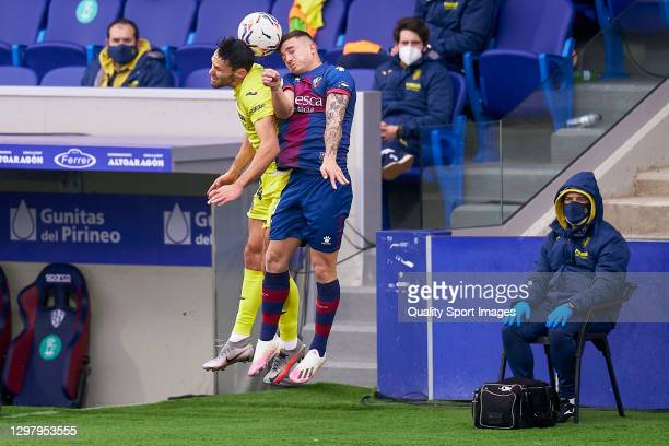 Pablo Maffeo of SD Huesca competes for the ball with Alfonso Pedraza of Villarreal CF during the La Liga Santander match between SD Huesca and...