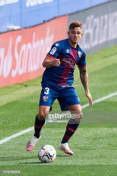 Pablo Maffeo of SD Huesca runs with the ball during the La Liga Santander match between SD Huesca and Cadiz CF at Estadio El Alcoraz on September 20...