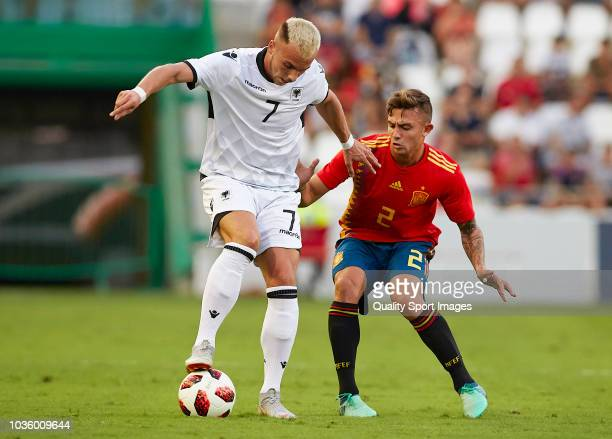 Pablo Maffeo of Spain competes for the ball with Taulan Sulejmanov of Albania during the 2019 UEFA Under 21 qualifier match between Spain U21 and...