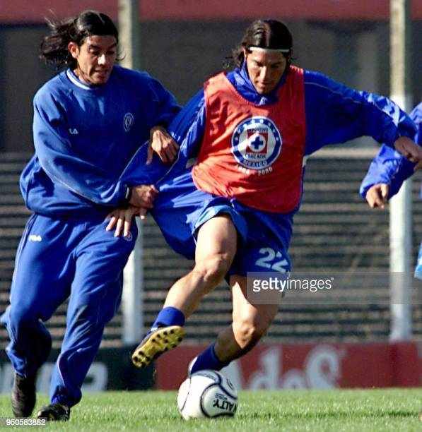 Pablo Manuel Galdames fights for the ball with a reserve player of Mexico's Cruz Azul during a training session at the Independiente Club in Buenos...
