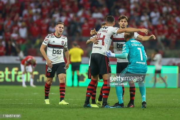 Pablo Marí of Flamengo celebrates with teammates the first goal of their team scored by Gabriel Barbosa during the match Internacional v Flamengo as...