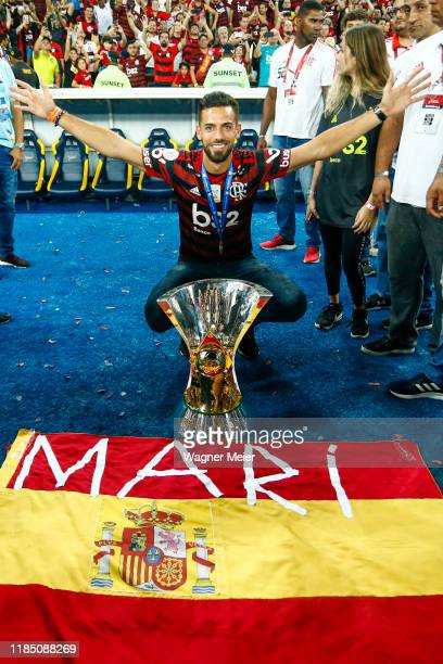 Pablo Marí of Flamengo poses with the trophy after winning the Brasileirao 2019 after the match against Ceará at Maracana Stadium on November 27,...