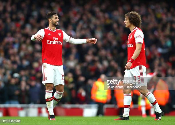 Pablo Mari and David Luiz of Arsenal celebrate after the Premier League match between Arsenal FC and West Ham United at Emirates Stadium on March 07...