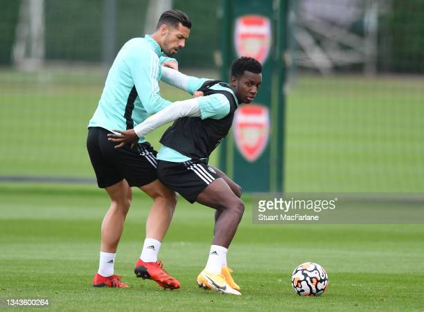 Pablo Mari and Eddie Nketiah of Arsenal during a training session at London Colney on September 28, 2021 in St Albans, England.