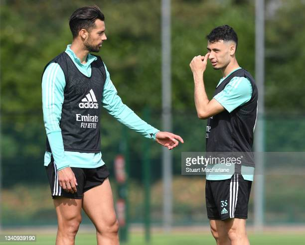 Pablo Mari and Gabriel Martinelli of Arsenal during a training session at London Colney on September 17, 2021 in St Albans, England.