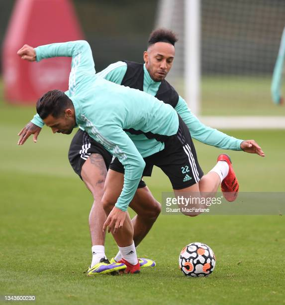 Pablo Mari and Pierre-Emerick Aubameyang of Arsenal during a training session at London Colney on September 28, 2021 in St Albans, England.