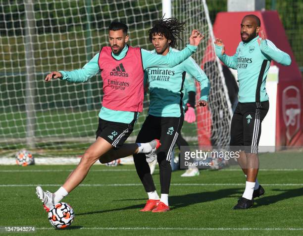 Pablo Mari, Mohamed Elneny and Alexandre Lacazette of Arsenal during the Arsenal 1st team training session at London Colney on October 21, 2021 in St...