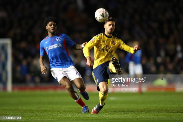 Pablo Mari of Arsenal battles for possession with Ellis Harrison of Portsmouth FC during the FA Cup Fifth Round match between Portsmouth FC and...