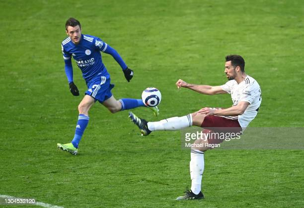 Pablo Mari of Arsenal battles for possession with Jamie Vardy of Leicester City during the Premier League match between Leicester City and Arsenal at...