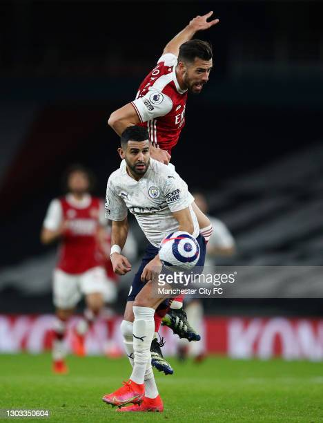 Pablo Mari of Arsenal battles for possession with Riyad Mahrez of Manchester City during the Premier League match between Arsenal and Manchester City...