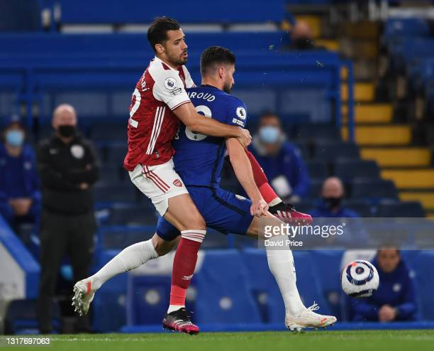 Pablo Mari of Arsenal challenges Olivier Giroud of Chelsea during the Premier League match between Chelsea and Arsenal at Stamford Bridge on May 12,...