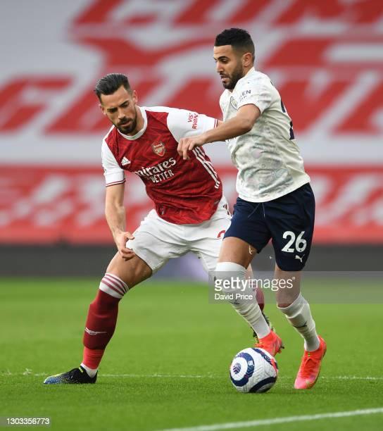 Pablo Mari of Arsenal closes down Riyad Mahrez of Man CIty during the Premier League match between Arsenal and Manchester City at Emirates Stadium on...