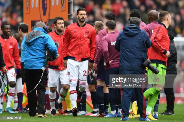 Pablo Mari of Arsenal does not shake hands with his opposition over fears about the coronavirus prior to the Premier League match between Arsenal FC...