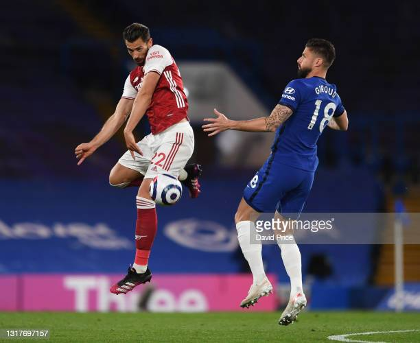 Pablo Mari of Arsenal heads the ball away from Olivier Giroud of Chelsea during the Premier League match between Chelsea and Arsenal at Stamford...