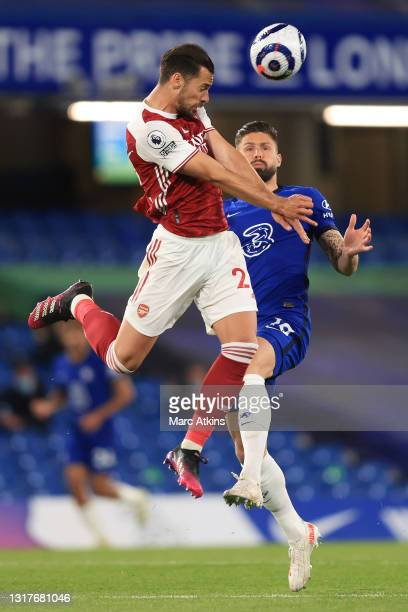 Pablo Mari of Arsenal wins a header from Olivier Giroud of Chelsea during the Premier League match between Chelsea and Arsenal at Stamford Bridge on...