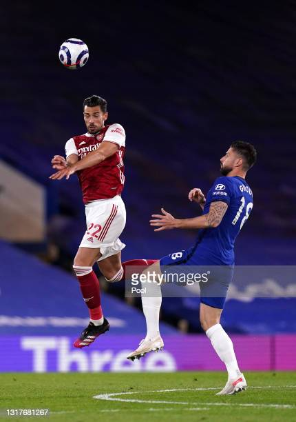 Pablo Mari of Arsenal wins a header whilst under pressure from Olivier Giroud of Chelsea during the Premier League match between Chelsea and Arsenal...