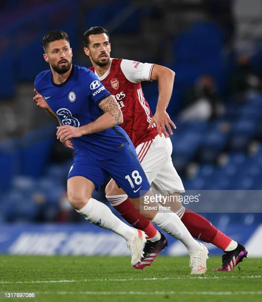 Pablo Mari of Arsenal with Olivier Giroud of Chelsea during the Premier League match between Chelsea and Arsenal at Stamford Bridge on May 12, 2021...