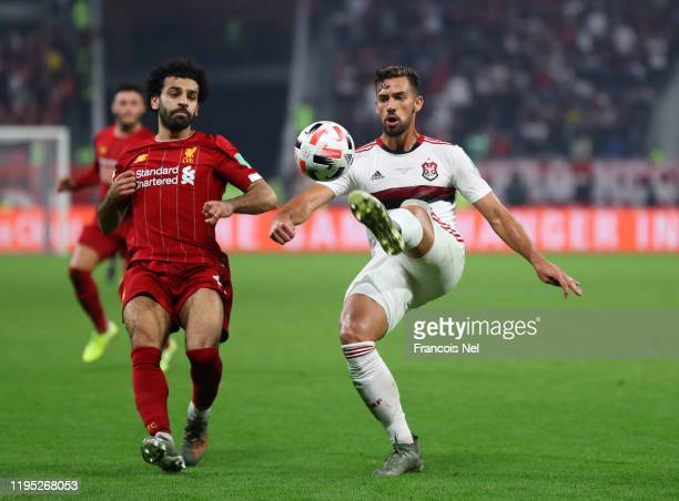 Pablo Mari of CR Flamengo controls the ball ahead of Mohamed Salah of Liverpool during the FIFA Club World Cup Qatar 2019 Final between Liverpool FC...