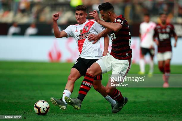 Pablo Mari of Flamengo fights for the ball with Julian Alvarez of River Plate during the final match of Copa CONMEBOL Libertadores 2019 between...