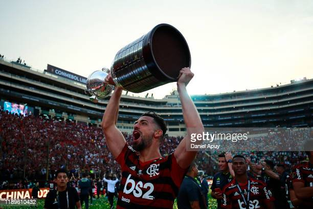 Pablo Mari of Flamengo lifts the trophy after winning during the final match of Copa CONMEBOL Libertadores 2019 between Flamengo and River Plate at...