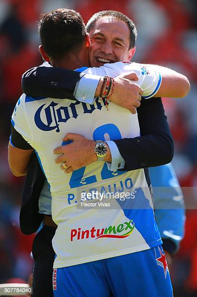 Pablo Marini head coach of Puebla celebrates with his player Patricio Araujo of Puebla during the fourth round match between Toluca and Puebla as...