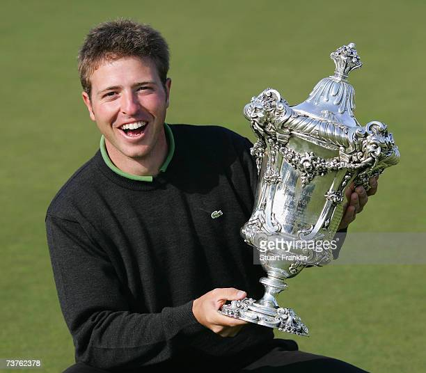 Pablo Martin Benavides of Spain holds the trophy as he becomes the first amateur to win a title on The European Tour after he won The Estoril Open de...