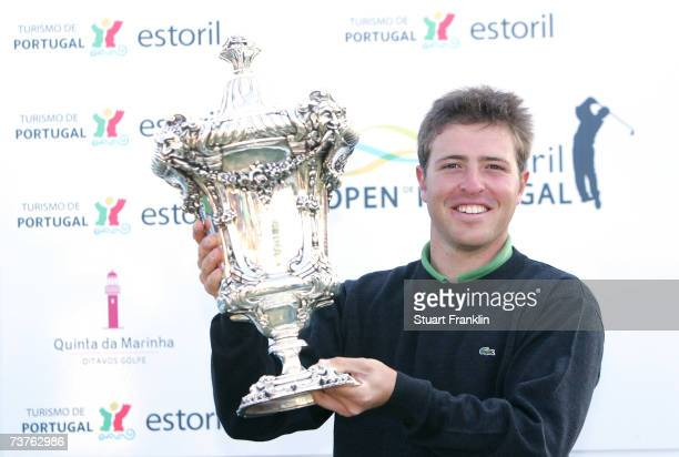 Pablo MartinBenavides of Spain holds the trophy after the final round of the Estoril Open de Portugal at The Quinta da Marinha Golf Course on April 1...