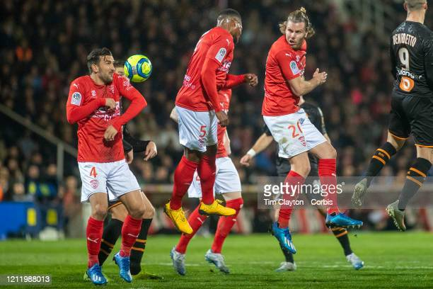 February 28: Pablo Martinez of Nimes, Loick Landre of Nimes and Renaud Ripart of Nimes defend a corner during the Nimes V Marseille, French Ligue 1,...