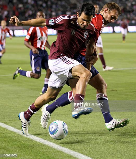 Pablo Mastroeni of the Colorado Rapids fights for the ball with Jimmy conrad of Chivas USA at The Home Depot Center on March 26 2011 in Carson...