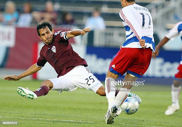 Pablo Mastroeni of the Colorado Rapids goes for the ball against Andre Rocha of the FC Dallas on July 11 2009 at Dicks Sporting Goods Park in...