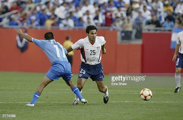 Pablo Mastroeni of the USA makes a short run past William Torres Alegria of El Salvador on July 12 2003 at Gillette Stadium in Foxboro Massachusetts...