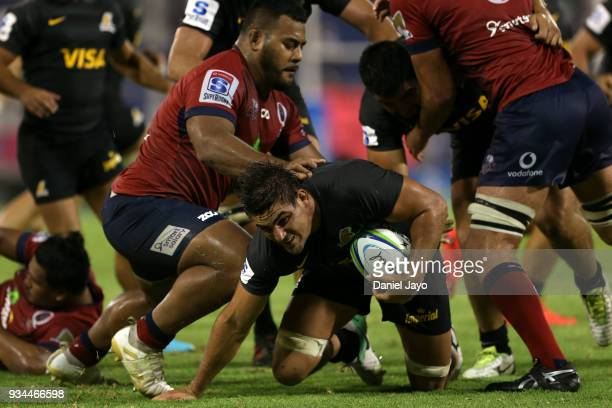 Pablo Matera of Jaguares is tackled by Taniela Tupou of Reds during a match between Jaguares and Reds as part of the fifth round of Super Rugby at...