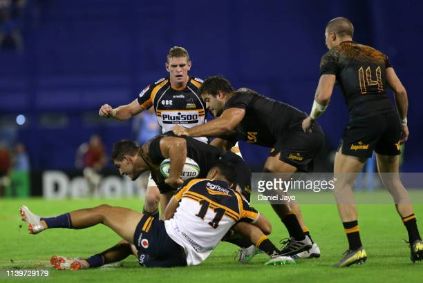 Pablo Matera of Jaguares is tackled by Toni Pulu of Brumbies during a Super Rugby Rd 11 match between Jaguares and Brumbies at Jose Amalfitani...