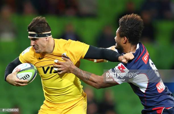 Pablo Matera of the Jaguares is tackled by Amanaki Mafi of the Rebels during the round 17 Super Rugby match between the Melbourne Rebels and the...