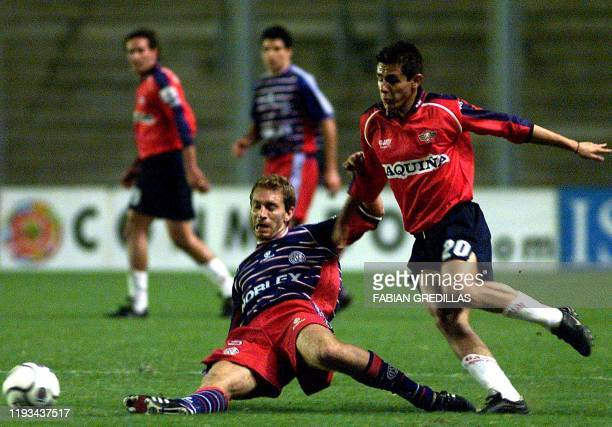 Pablo Michelini of San Lorenzo fights for the ball with Sacha Lima of Jorge Wilstermann 03 April 2001 in Buenos Aires Argentina during a match for...
