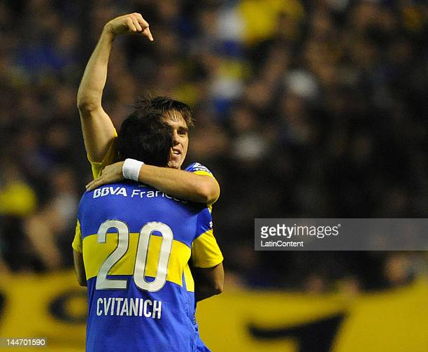 Pablo Mouche hughs Dario Cvitanich to celebrate the goal of Boca Juniors against Fluminense during a match as part of the Santander Libertadores Cup...