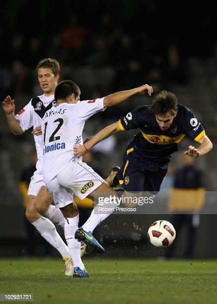 Pablo Mouche of the Boca Juniors runs into Rodrigo Vargas of the Melbourne Victory during the preseason International Friendly between Melbourne...