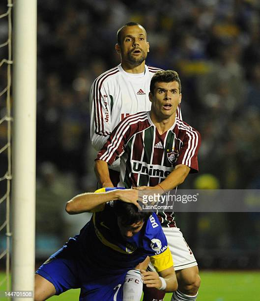 Pablo Mouche receives a foul prior to a corner kick during a match as part of the Santander Libertadores Cup at Alberto J Armando Stadium on Mayo 17...