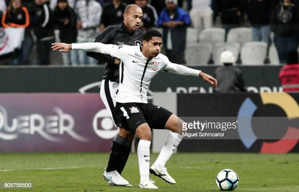 Pablo of Corinthians vies for the ball with Roger of Botafogo during the match between Corinthians and Botafogo for the Brasileirao Series A 2017 at...